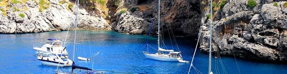 multiple sailboats at anchor